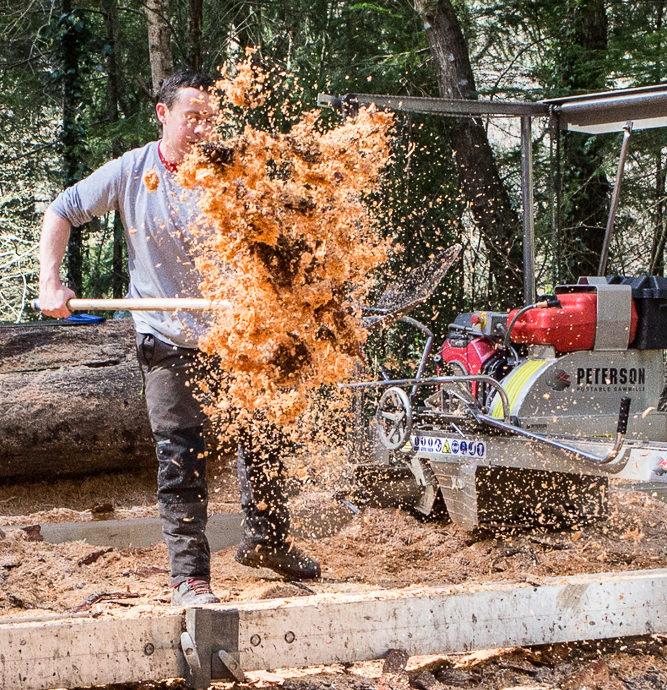 Sawdust Flung from Shovel towards camera