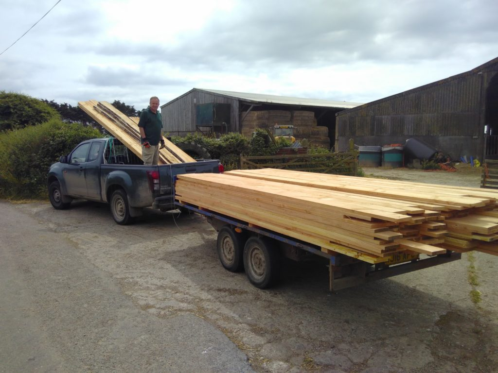 Pick-up and trailer load of larch